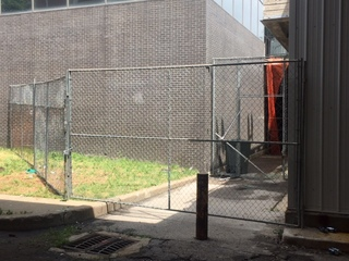 New fencing for troubled Flashcube Building