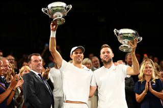 Sock teams up to win doubles title at Wimbledon