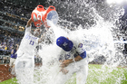 Royals douse the Cubs, salvage series finale