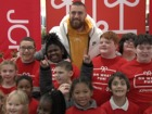 Travis Kelce surprises kids with shopping spree